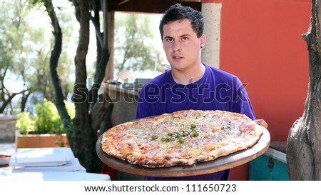 Handsome young waiter portrait. - stock photo
