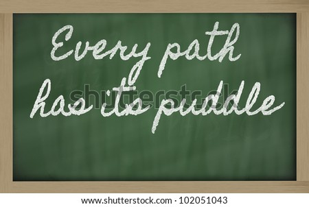 handwriting blackboard writings -  Every path has its puddle - stock photo