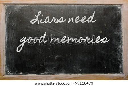 handwriting blackboard writings - Liars need good memories - stock photo