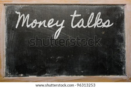 handwriting blackboard writings - Money talks - stock photo