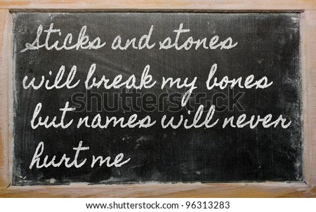 handwriting blackboard writings - Sticks and stones will break my bones but names  will never hurt me - stock photo