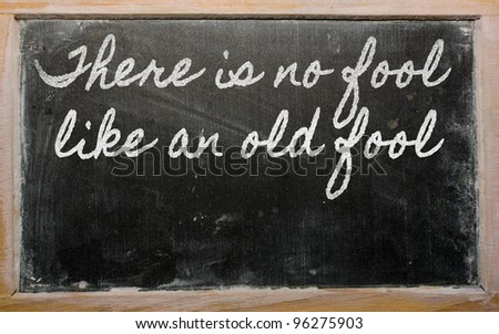 handwriting blackboard writings - There is no fool like an old fool - stock photo