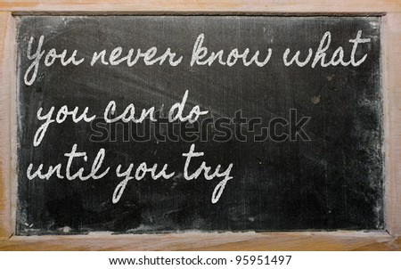 handwriting blackboard writings - You can't teach an old dog new tricks - stock photo