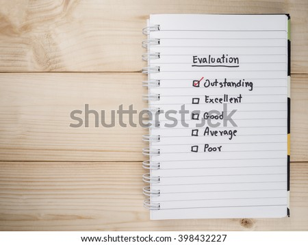 Handwriting Performance Evaluation check box on white notebook (Business concept) - stock photo