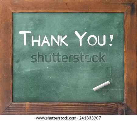 Handwriting text for THANK YOU on green board. - stock photo