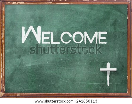 Handwriting text for WELCOME and symbol for the CROSS on green board. - stock photo