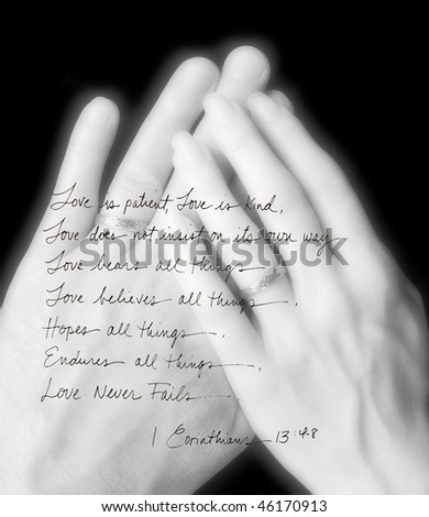handwritten Corinthians layered over married hands - stock photo