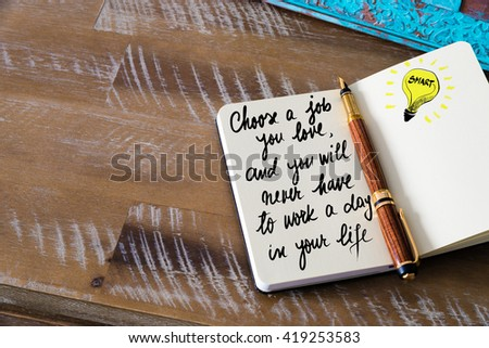 Handwritten text Choose a job you love, and you will never have to work a day in your life with fountain pen on notebook. Concept image with copy space available. - stock photo