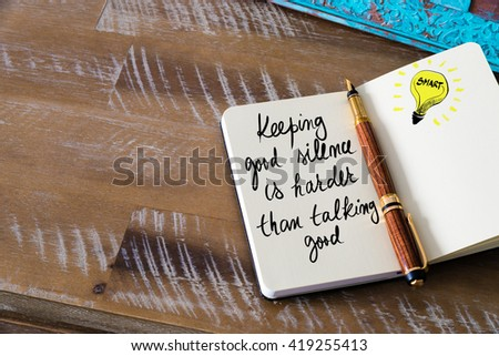Handwritten text Keeping good silence is harder than talking good with fountain pen on notebook. Concept image with copy space available. - stock photo