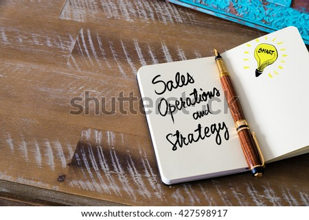 Handwritten text Sales, Operations and Strategy with fountain pen on notebook. Concept image with copy space available. - stock photo