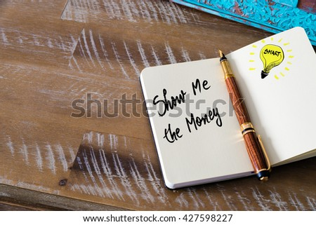 Handwritten text Show Me The Money with fountain pen on notebook. Concept image with copy space available. - stock photo