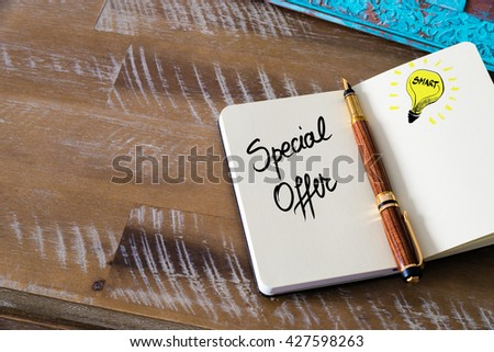 Handwritten text Special Offer with fountain pen on notebook. Concept image with copy space available. - stock photo