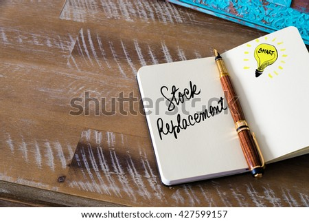 Handwritten text Stock Replacement with fountain pen on notebook. Concept image with copy space available. - stock photo