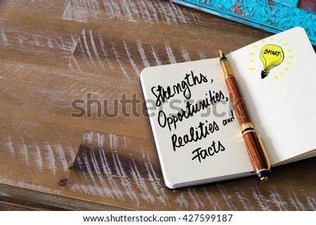 Handwritten text  Strengths, Opportunities, Realities, Facts with fountain pen on notebook. Concept image with copy space available. - stock photo