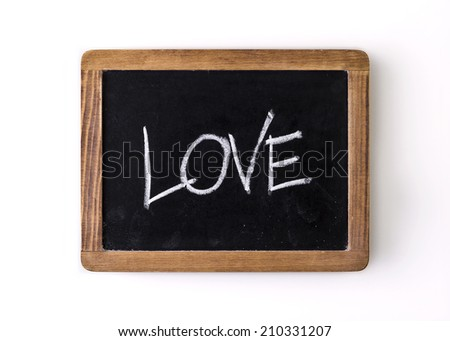 "Handwritten with chalk on a blackboard: word ""Love"" - stock photo"