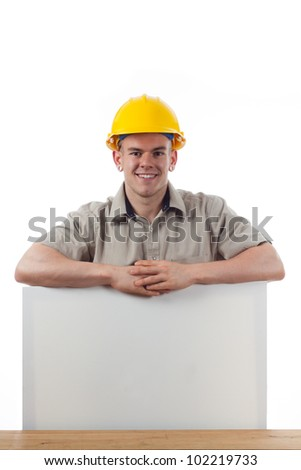 Handy man with a blank signage board - stock photo