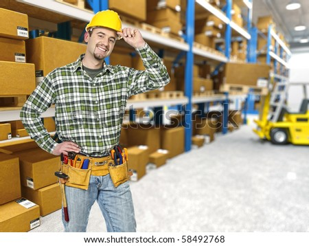 handyman, classic warehouse and forklift in action - stock photo