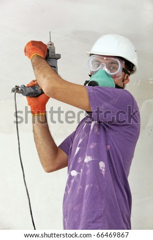 Handyman holding drill - stock photo