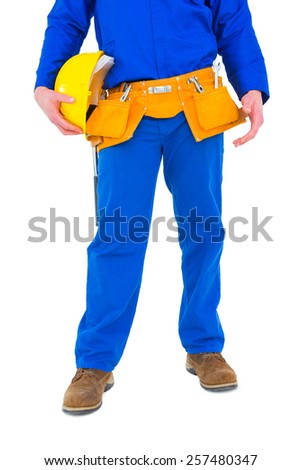 Handyman holding helmet on white background - stock photo