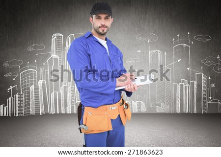 Handyman in blue overall writing on clipboard against hand drawn city plan - stock photo