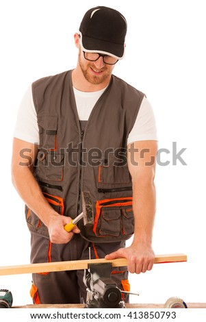 Handyman in work clothing hammering nail with hammer in home workshop isolated over white. - stock photo