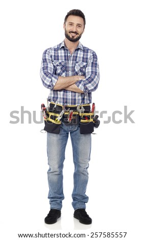Handyman with arms crossed - stock photo