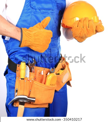 Handyman with helmet and workers belt full of tools isolated on white background - stock photo