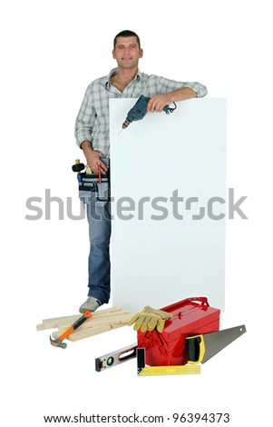 Handyman with tools and message board - stock photo