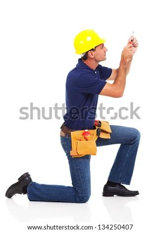 handyman working using screwdriver over white background - stock photo