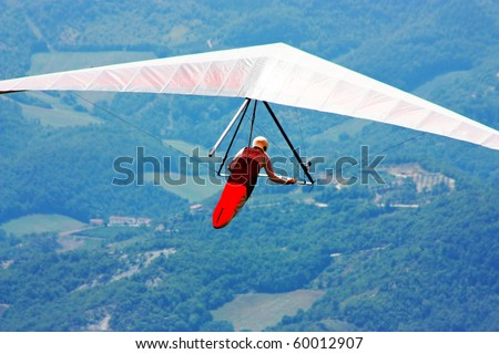 Hang glider flying in the Italian Apennines - stock photo