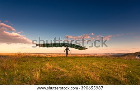 Hang glider on takeoff line before the flight.  - stock photo