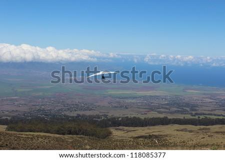 Hang Gliding in Maui Hawaii Skies - stock photo