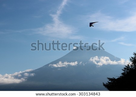 Hang gliding with mt Fuji in blue sky - stock photo