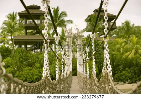 hanged rope-way leading to the observation towers at the famous Sentosa island in Singapore - stock photo