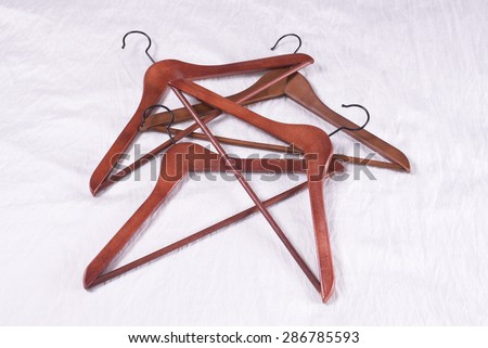 Hanger on the bed - stock photo