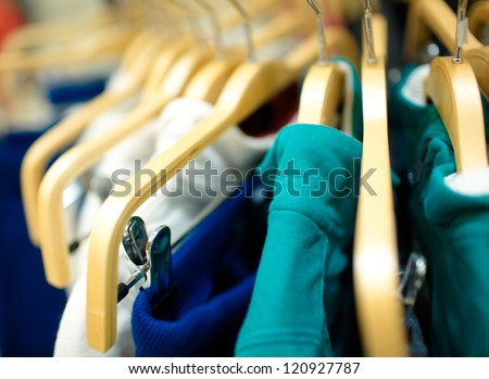 Hangers in the clothes store. Shallow dof. - stock photo