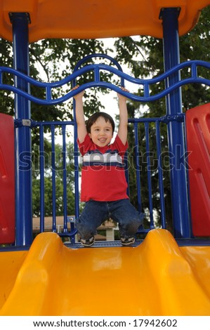 Hanging at the top of a slide - stock photo