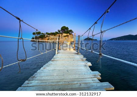 Hanging bridge to the island at night, Zakhynthos in Greece - stock photo