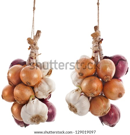 hanging bunch bundle of onion and garlic clove isolated on white background - stock photo