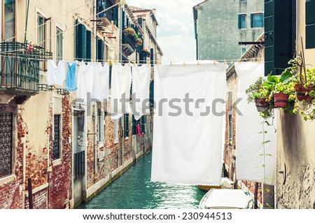 Hanging clothes over a canal in Venice, Italy. - stock photo