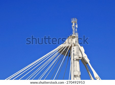 Hanging farm with flexible spacer truss rods (guys), suspended from the supports - stock photo