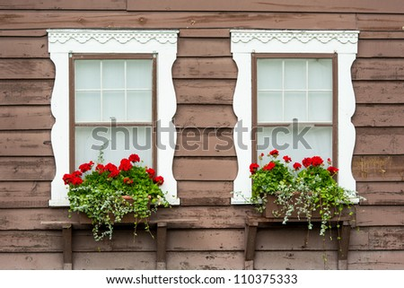 Hanging flowers under window of the Many Glacier Hotel in Glacier National Park, Montana - stock photo