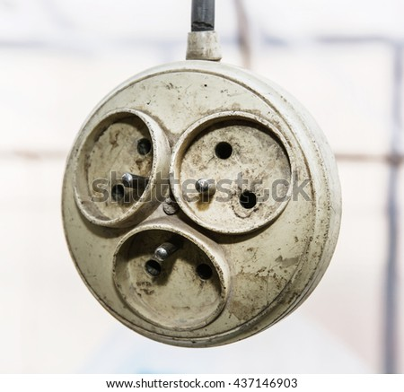 Hanging old dirty multiple electrical outlet. Supply electricity. Power bar. - stock photo