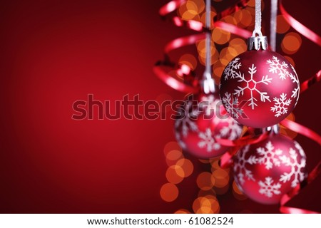 Hanging red christmas balls with copy space. - stock photo