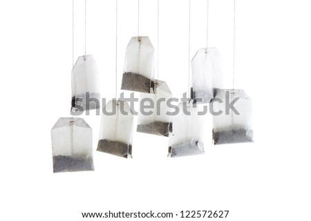 Hanging tea bags in a close-up image - stock photo