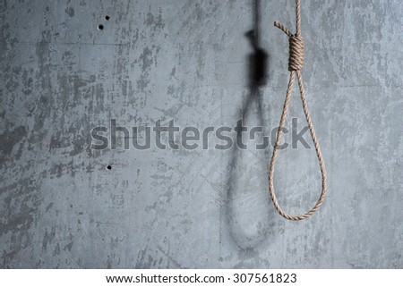 Hangman's loop over the concrete wall - stock photo