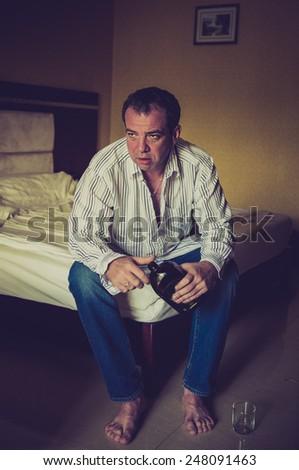 Hangover. Man with a headache. LOMO effect - stock photo