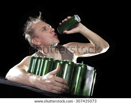 Hangover. The man wants to drink the last drink of beer from an empty can - stock photo