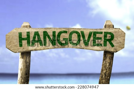 Hangover wooden sign with a beach on background - stock photo
