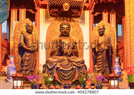 HANGZHOU, CHINA - APR 2, 2016: Buddha statue at one of the Buddha pagodas at the Lingyin Temple (Temple of the Soul's Retreat) complex. One of the largest  Buddhist temples in China - stock photo